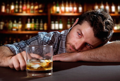alcoholic drunk man thoughtful on alcohol addiction at bar of pub
